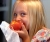 Girl eating a peach_Bruce Tuten