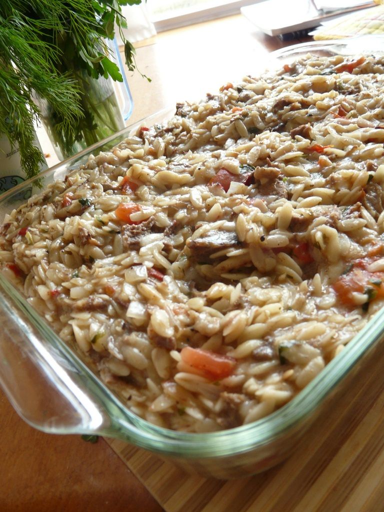 Orzo and lentil cassarole in a glass dish