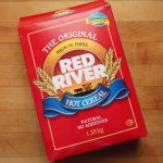 A box of Red River Cereal on a table top