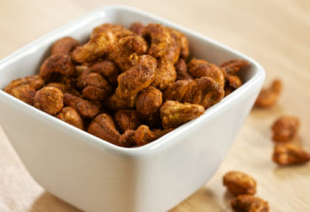Curried cashews in a white serving dish
