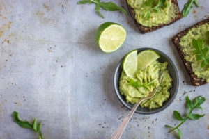 Guacamole with lime on whole grain toast