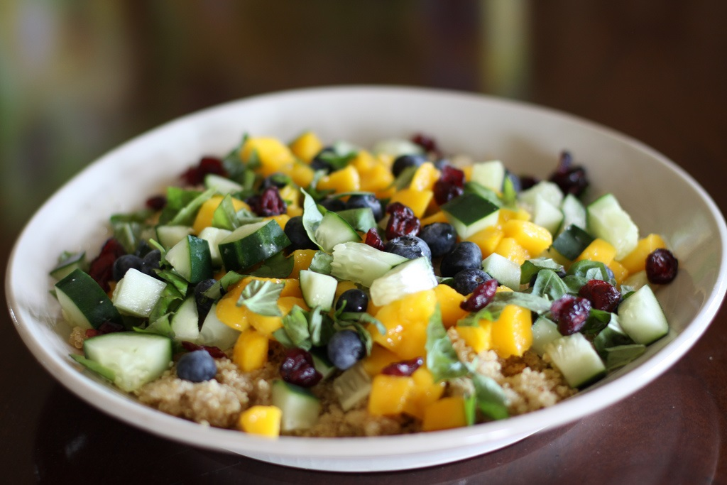 Quinoa blueberry mango salad in a white bowl