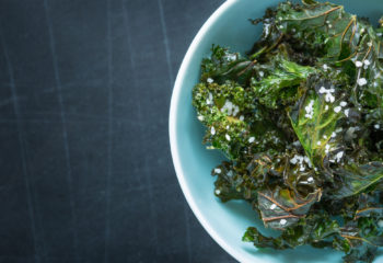 Kale chips with sea salt in a blue bowl