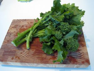 Fresh rapini on a cutting board
