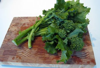 Broccoli rabe on a wooden cutting board - by Doug Cook RD