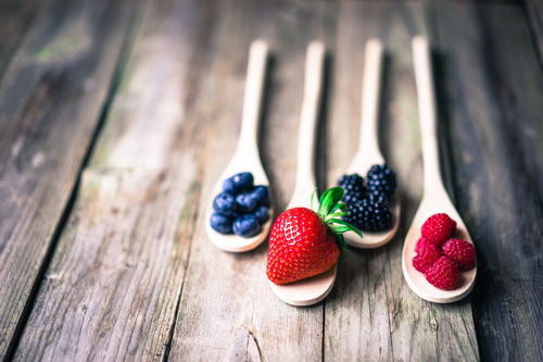 Berries on wooden spoons - Antioxidant Rich Berries. Tasty Kick-Ass Nutrition