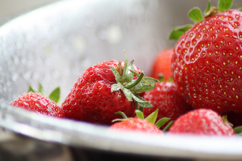 Fresh washed strawberries in a metal bowl - by Doug Cook RD