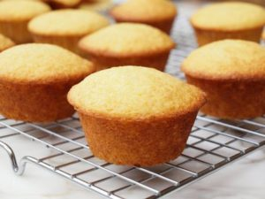 Cornmeal muffins cooling on a rack