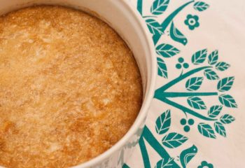 Quinoa pudding in a white ramekin