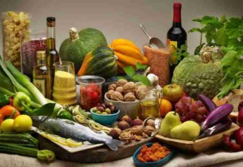 Mediterranean foods including olive, fish, fruits, vegetables nuts and seeds