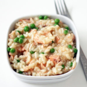 Bowl of salmon and pea risotto