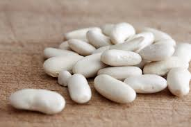 Uncooked white navy beans on a table top