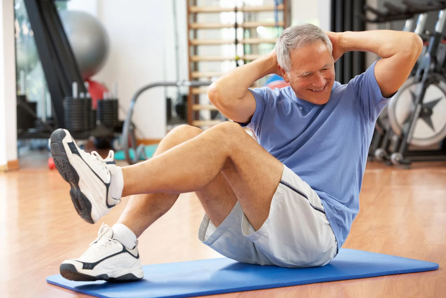 An older man doing exercises at the gym
