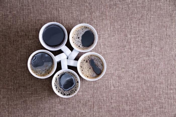 Five cups of coffee on a table