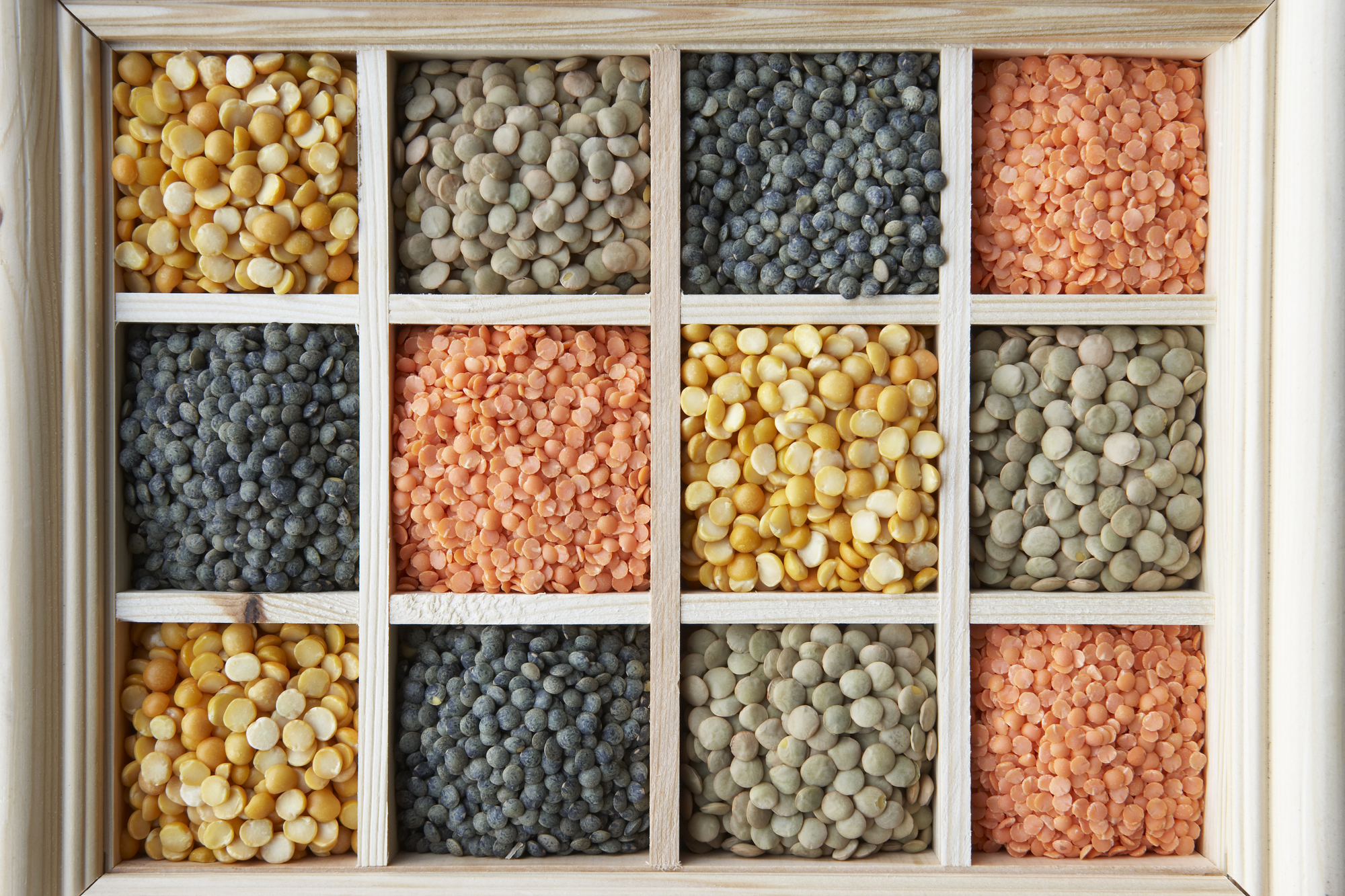 Different types of lentils in a display box