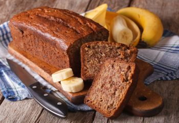 Homemade banana bread sliced on a table close-up. horizontal, rustic style