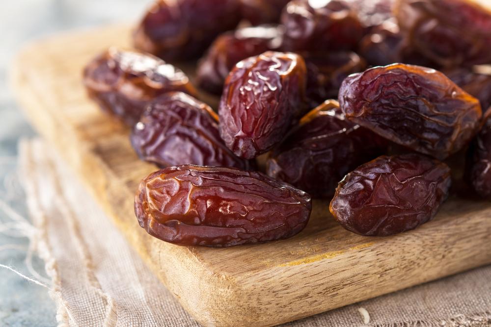 Dried dates on a cutting board