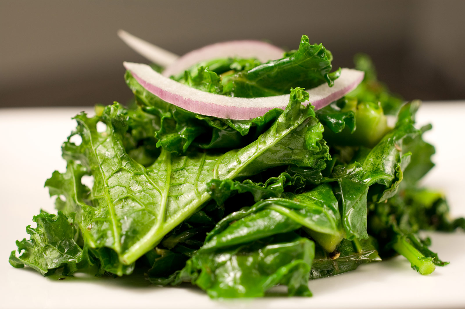 Cooked kale with red onion
