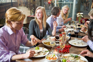 Dining friends 300x200 - Unhealthy Health Foods. Is There Such A Thing?