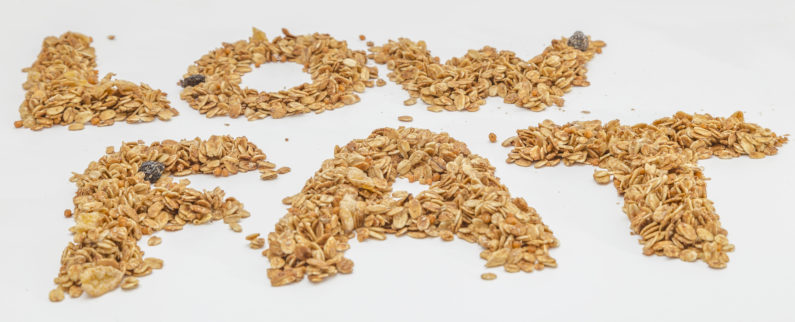 The word low fat spelled out with granola