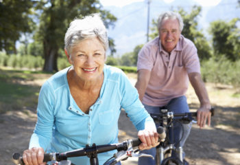 An older couple out riding their bikes