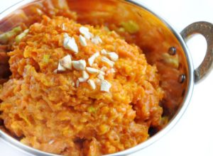 A dish with carrot pudding with cashew nuts