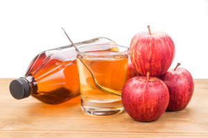 Apple cider vinegar in jar, glass and fresh apple, healthy drink - by Doug Cook RD