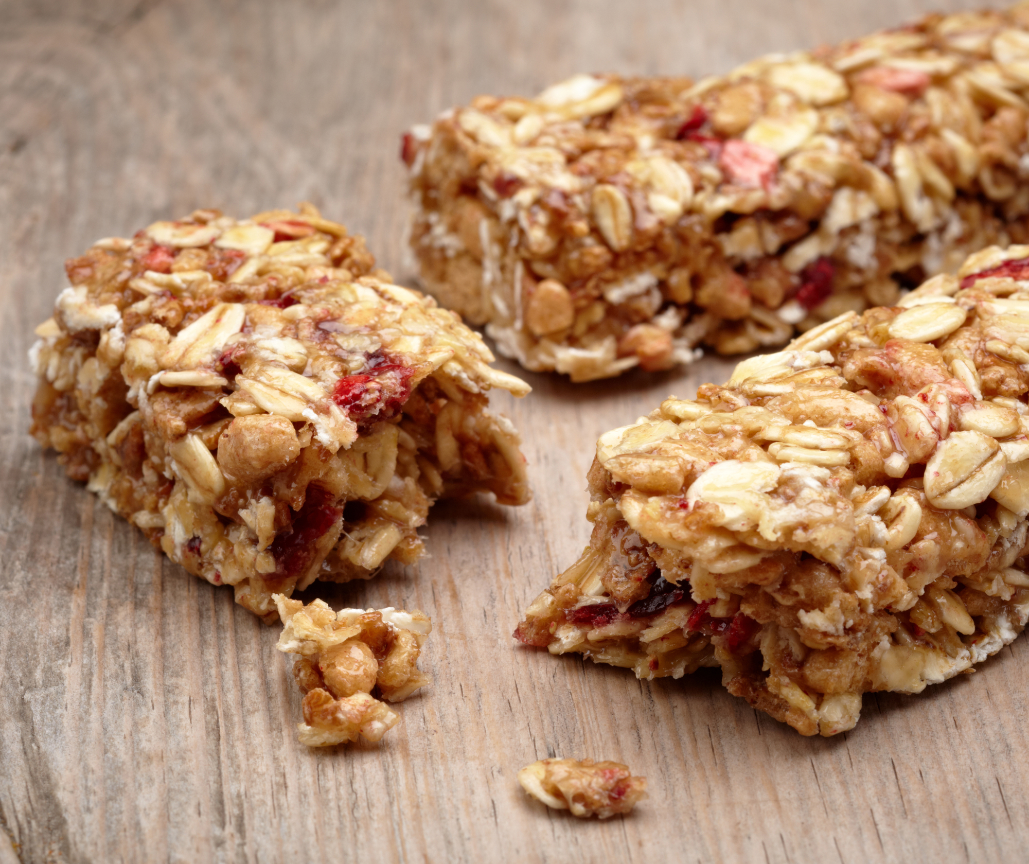 Pieces of oat fruit and nut bars on a table top