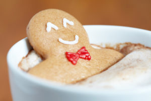Gingerbread man in latte 300x200 - 11 Ways For You (And Your Gut) To Survive The Holidays