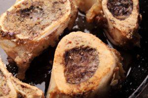 Roasted beef bones in a pan