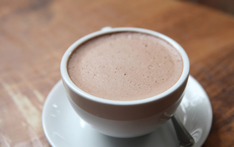 hot chocolate in a white cup on a table