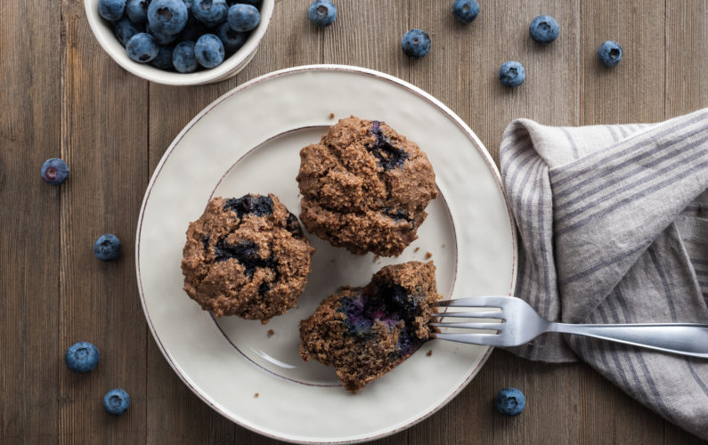 Red River cereal blueberry muffin on a plate with fork