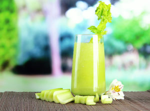 Glass of celery juice, on bamboo mat,