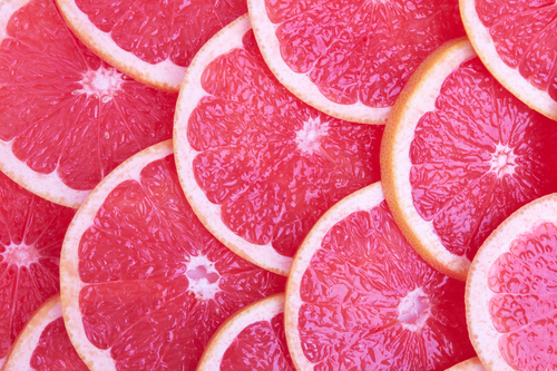 Fresh red grapefruit and slices - by Doug Cook RD