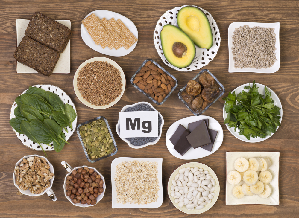 Food sources of magnesium on a wooden table