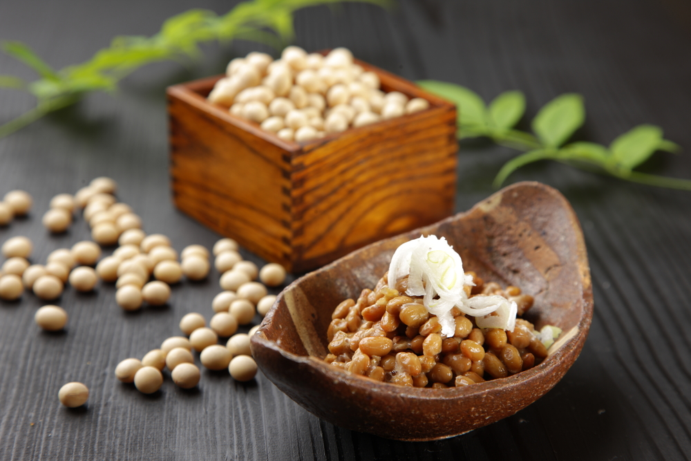 Natto and fresh soybeans in a wooden bowl
