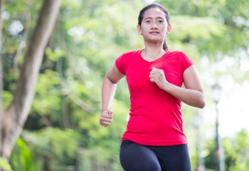 Young asian woman jogging at the park - by Doug Cook RD