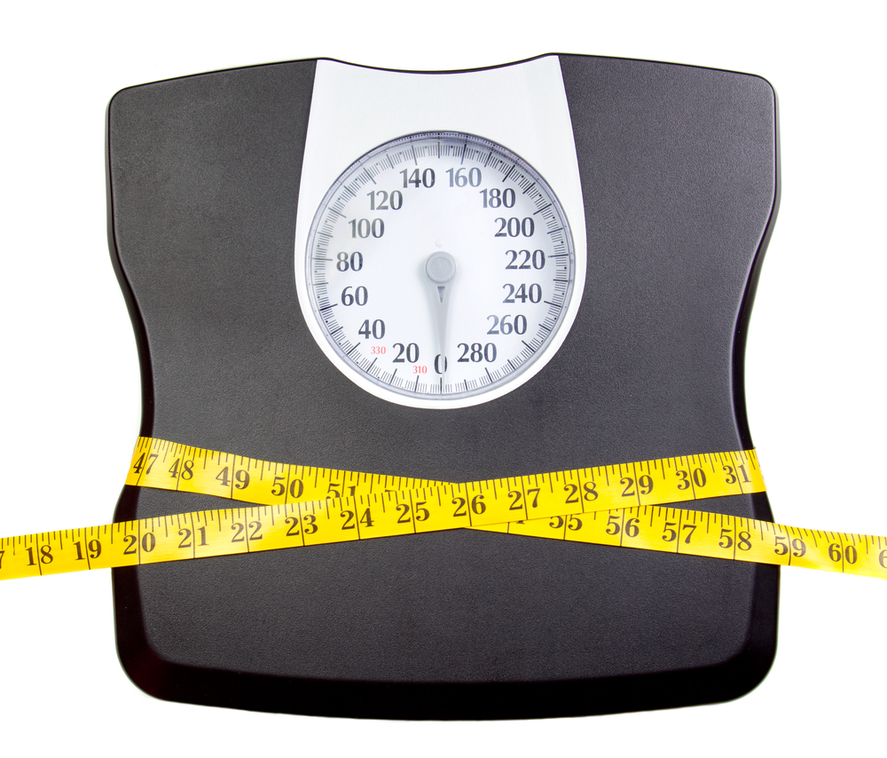 Scale and measuring tape - Are You Skinny Fat?